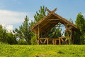 Summer wooden arbor made of wood standing on a meadow Royalty Free Stock Photos