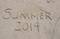 Summer in written in the sand words and numbers on beach Stock Photos