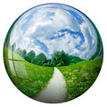 Summerdays scenery with sky reflected in a sphere Royalty Free Stock Images