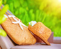 Summertime accessories straw hat and bag decorated with starfish lying on sunbed in the garden on beach resort travel and tourism Stock Photo