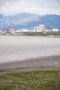 Summertime bootleggers cove anchorage alaska united states north sandy beach bay downtown city skyline Royalty Free Stock Photo