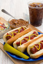 Summertime hotdogs grilled with summer time sides on a picknic table Royalty Free Stock Photo
