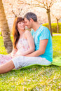 Summertime park romantic couple outdoors in green Royalty Free Stock Images