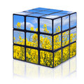 Summertime puzzle cube a with a summer scene on all sides on a white background with reflection Stock Photos