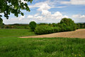 Summertime rural landscape view of a farmland with green grass and fields Royalty Free Stock Photo