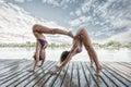 Summertime yoga couple of women doing yoga on river raft