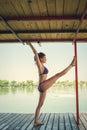Summertime yoga woman doing yoga on river raft
