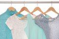 Summery blouses are on coat hangers Royalty Free Stock Photography