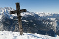 Summit cross on jenner mountain with view to watzmann in winter berchtesgaden germany Royalty Free Stock Images