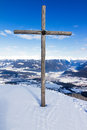 Summit cross wooden on top of a mountain in the italian alps on a sunny clear day Stock Photos