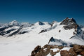 Summit of jungfrau right a meter peak in the bernese highlands and rottalhorn left seen from ascend to mount monch Royalty Free Stock Images