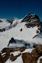 Summit of jungfrau right a meter peak in the bernese highlands and rottalhorn left seen from ascend to mount monch Stock Photo