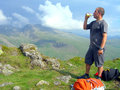 Summit of yewbarrow cumbria a fell walker relaxing with a drink on the england uk Stock Image