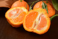 Sumo oranges sliced a wrinkly sweet orange that is a cross between a mandarin and california navel orange Stock Photos