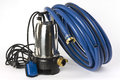 Sump pump and water hose a submersible for dirty a blue on a white background displayed Royalty Free Stock Photos