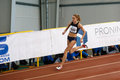SUMY, UKRAINE - FEBRUARY 17, 2017: Anna Drozdova compete in the women`s 400m running in an indoor track and field event.