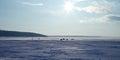 Sun above frozen lake Stock Photography