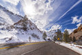 Sun above a mountain road in Zion National Park, Utah, USA. Royalty Free Stock Photo