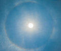 Sun be encircled by a halo image of Stock Images