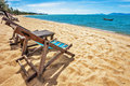Sun beach chairs at the beach on shore near sea thailand Royalty Free Stock Image