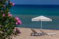 Sun beds exotic beach photo taken greece Stock Images