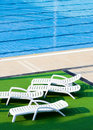 Sun beds by swimming pool Royalty Free Stock Photography