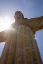 Sun behind Christus Rei Statue in Lisbon, Portugal