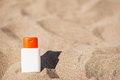 Sun block creme on sand Royalty Free Stock Photography