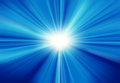 Sun on blue sky with lenses flare blurred rays of light abstract background Stock Photos