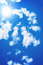 Sun among the blue sky and white clouds Royalty Free Stock Photo