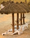 Sun chairs and huts on the beach of a resort in mexico white under sit shade at manzanillo Royalty Free Stock Photo
