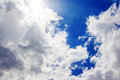 Sun in clouds on blue sky with flare Royalty Free Stock Photos