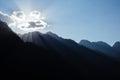 Sun in clouds during sunset in himalayan mountains kasol himachal pradesh india Stock Image