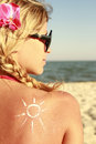 Sun cream on the female back on the beach of Stock Images