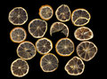 Sun dried dried lemon close up on a black background Royalty Free Stock Image