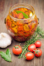 Sun dried tomatoes in olive oil Stock Photo