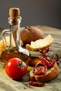 Sun dried tomatoes, white bread and olive oil. Stock Photography