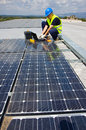 Sun energy craftsman at work in a plant for photovoltaic Royalty Free Stock Photos