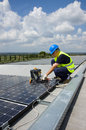 Sun energy craftsman at work in a site to build a photovoltaic plant for Royalty Free Stock Images