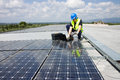 Sun energy engineer at work in photovoltaic plant Stock Image