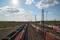 Sun and freight trains at railway station with old railroads summer day above view Stock Photography