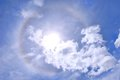 Sun halo with blue sky and white cloud Stock Image