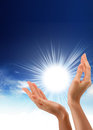 Sun in the hands concept Stock Image