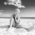 Happy healthy girl on seacoast with retro photo camera Royalty Free Stock Photo