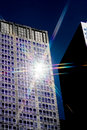 Sun lighting up tall building Royalty Free Stock Photo