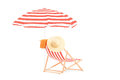 Sun lounger with stripes and umbrella isolated on white background Royalty Free Stock Photo