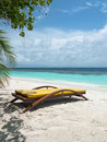 Sun lounger on tropical beach Royalty Free Stock Photos