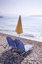 Sun lounger and umbrella on empt beach empty sandy Royalty Free Stock Photos