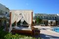 Sun loungers around pool hotel Stock Photography