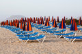 Sun loungers on beach line of and umbrellas a sandy Royalty Free Stock Photos